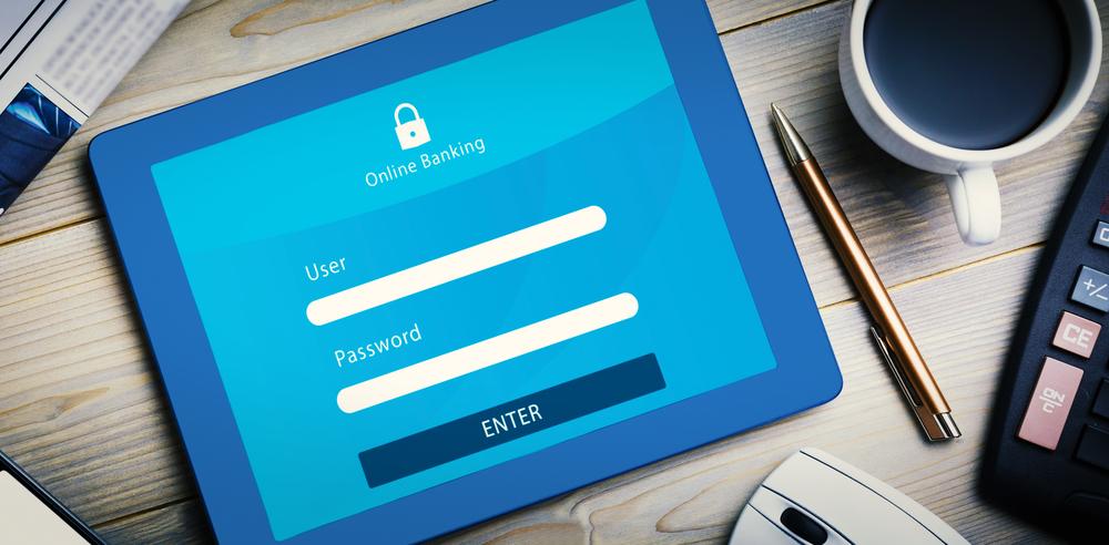 Online banking against tablet pc on desk